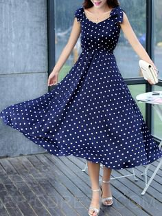 dark blue polka dot fit and flare maxi dress with silver heels