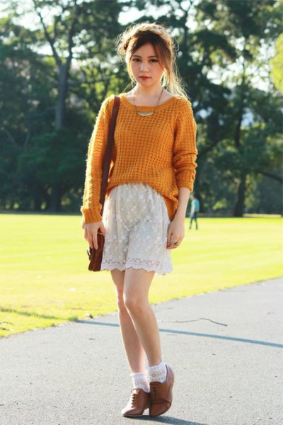 green ribbed knit sweater with white lace shorts