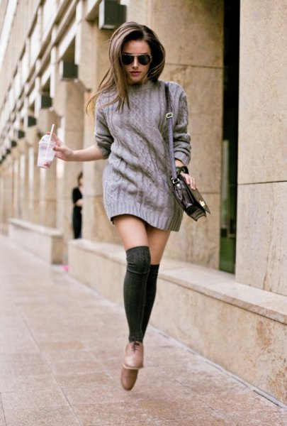 grey cable knit sweater dress with thigh high socks and light brown leather shoes