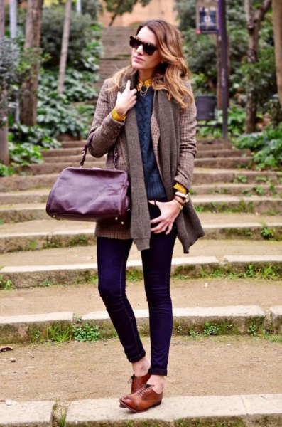 grey cardigan with navy pullover sweater and dark skinny jeans