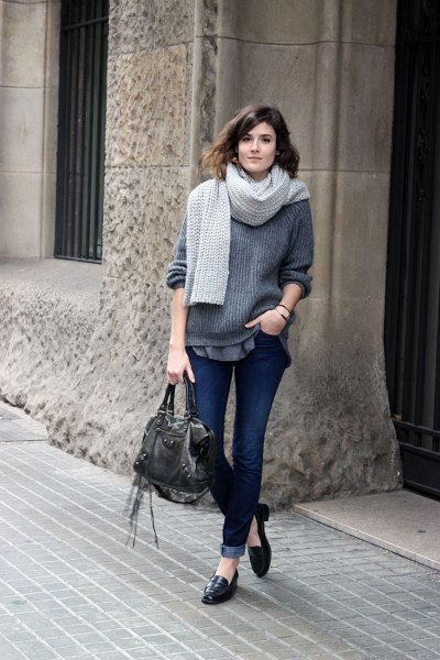 grey chunky sweater with knit scarf and cuffed jeans