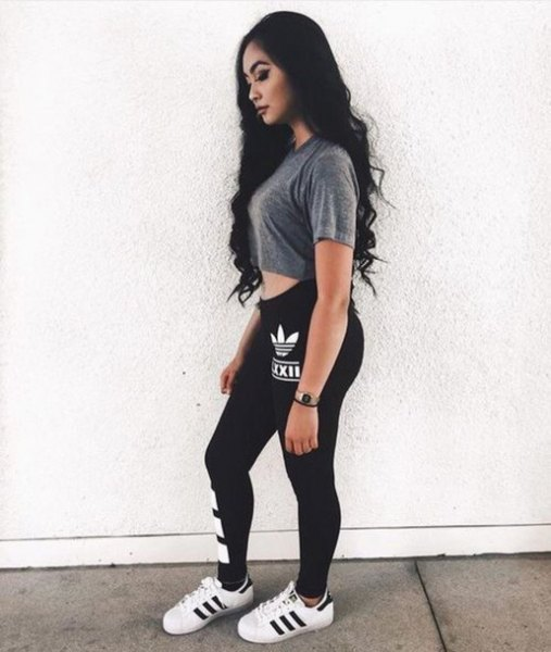 grey cropped t shirt with black adidas leggings and white sneakers