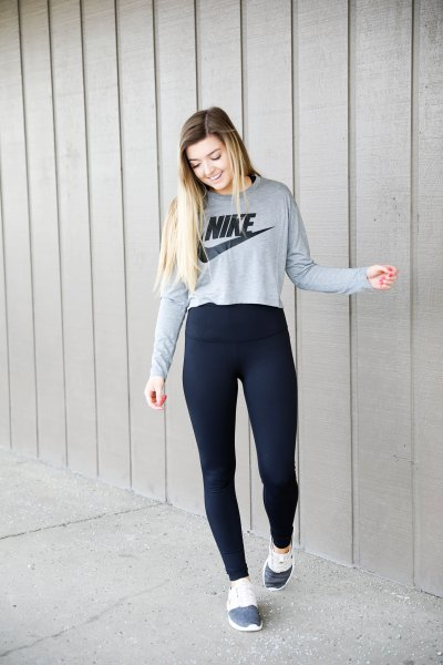 grey printed sweatshirt with black high rise leggings