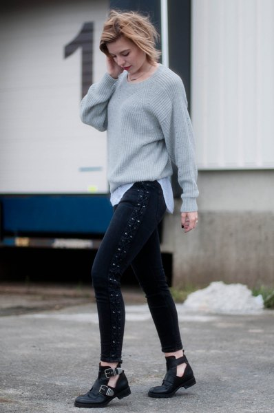 grey ribbed chunky knit sweater with black lace up skinny jeans