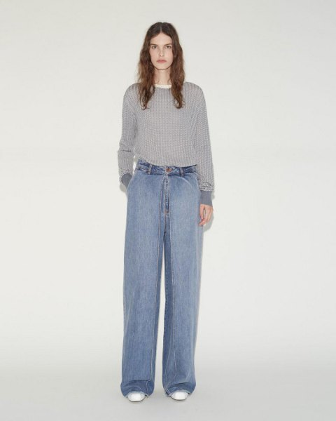 grey ribbed sweater with light blue wide leg pleated jeans