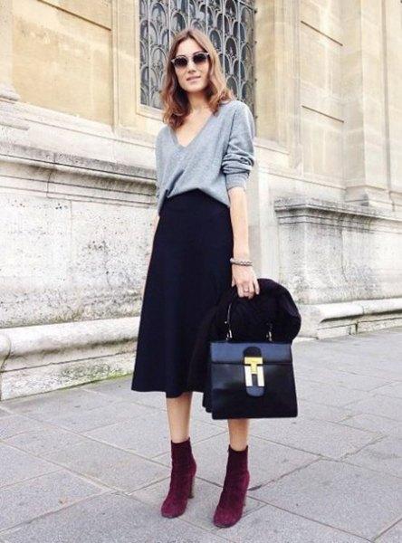 grey v neck sweatshirt with black flared midi dress
