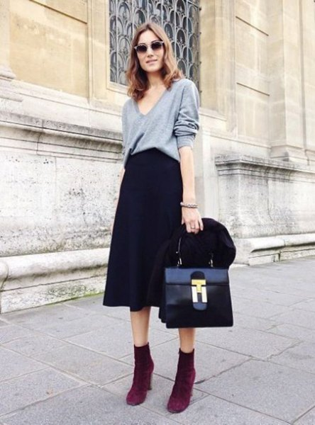 grey v neck sweatshirt with black flared midi dress