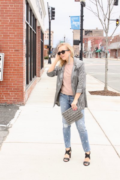 grey windbreaker with blush tee and black sandals