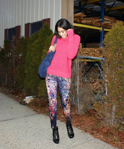 hot pink mock neck ribbed chunky sweater with paint splatter jeans
