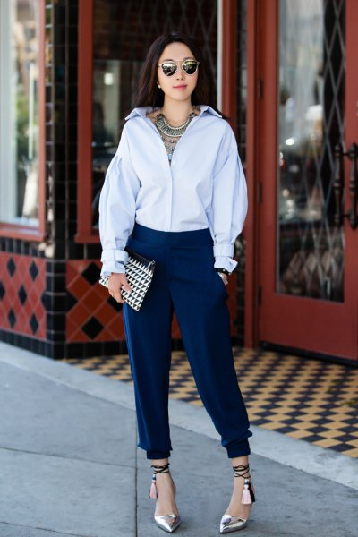 light blue button up shirt with dark tapered leg pleated jeans
