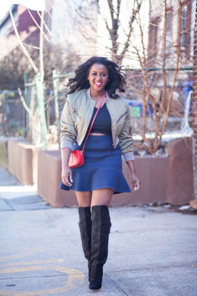 light grey short bomber jacket with blue mini skater skirt