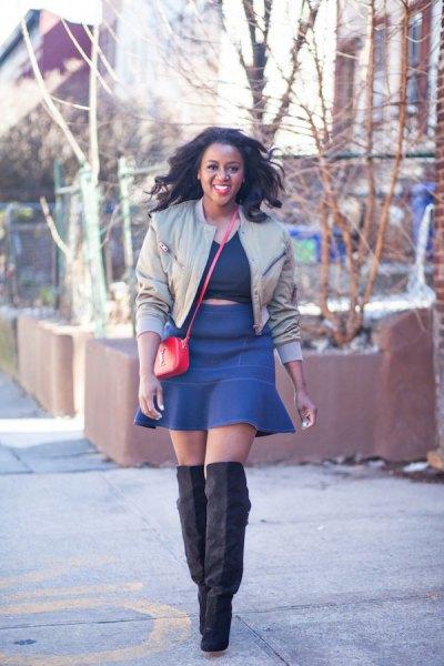 light grey short bomber jacket with blue mini skater skirt