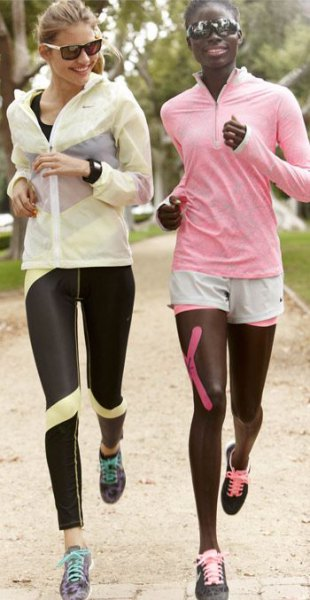 light pink windbreaker with black and yellow running tights