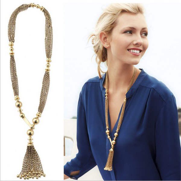 long boho style gold chain with navy blue chiffon blouse