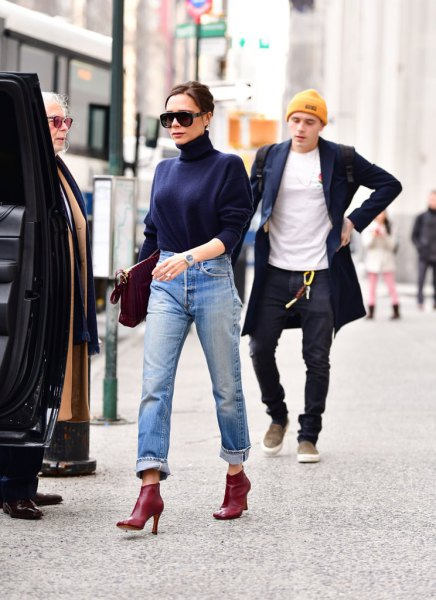 navy blue mock neck sweatshirt with cuffed boyfriend jeans