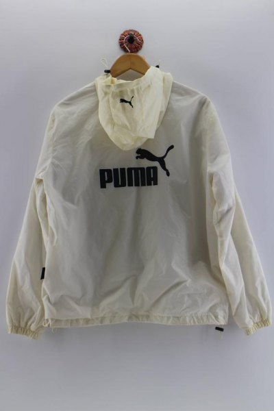 pale yellow puma windbreaker with light blue skinny jeans