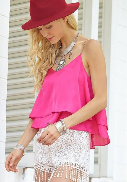 pink chiffon sleeveless top with mini white lace shorts