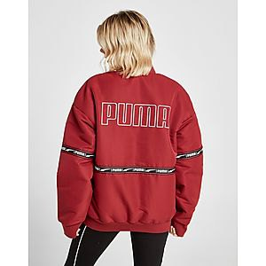 red oversized windbreaker with black leggings