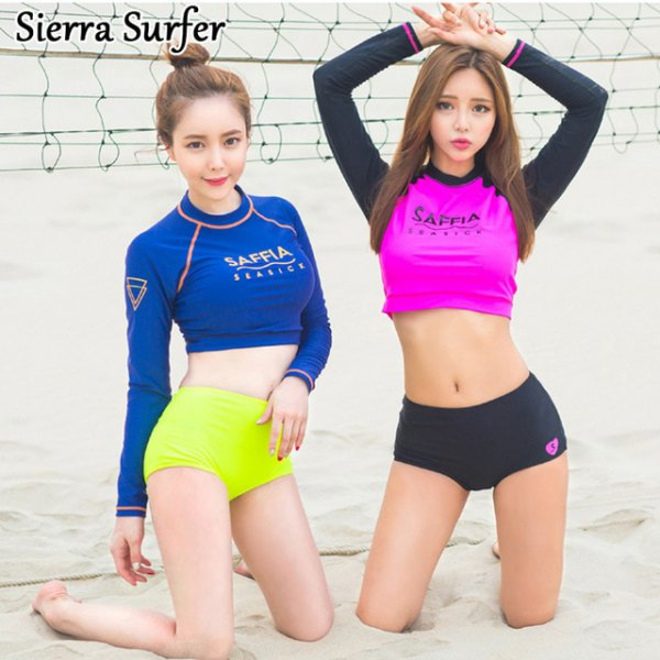 royal blue long sleeve cropped surfing tee with yellow swim shorts