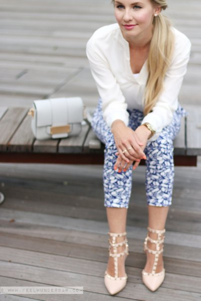 sweater with black printed cropped slim fit pants and white kitten heels