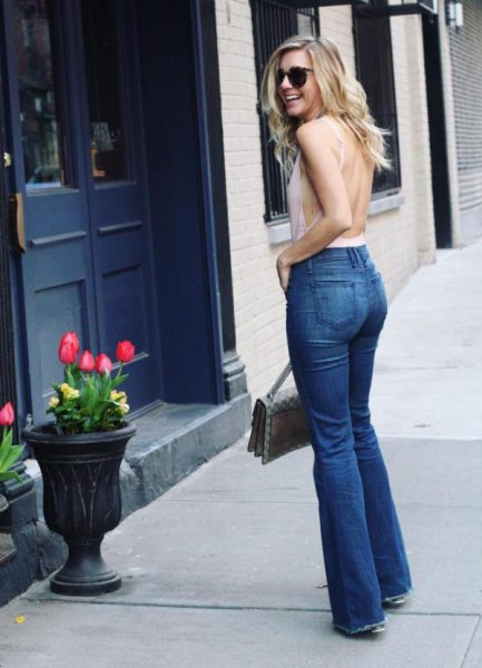 white backless tank top with blue flare jeans