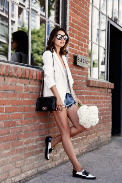 white blazer with denim mini short and black and white dress shoes