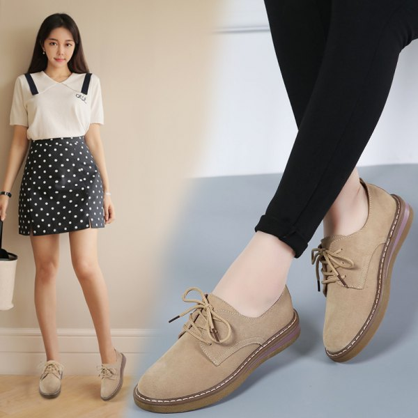 white blouse with black polka dot mini skirt and light camel suede shoes