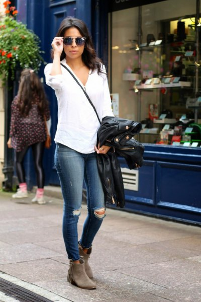 white button up shirt with dark blue ripped skinny jeans