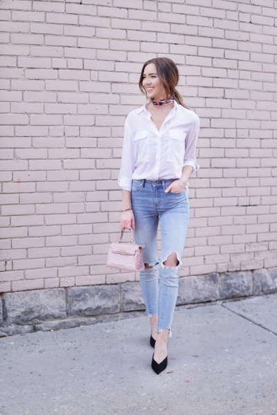 white button up shirt with light blue ripped knee jeans