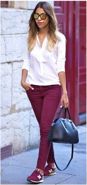 white button up slim fit blouse with burgundy skinny jeans and matching shoes