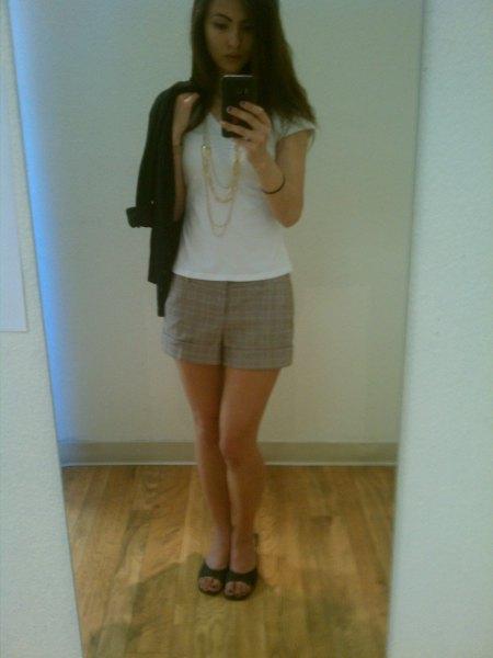 white cap sleeve t shirt with grey plaid mini skirt and black kitten heel sandals