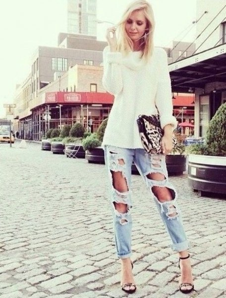white chunky knit sweater with light blue ripped boyfriend jeans