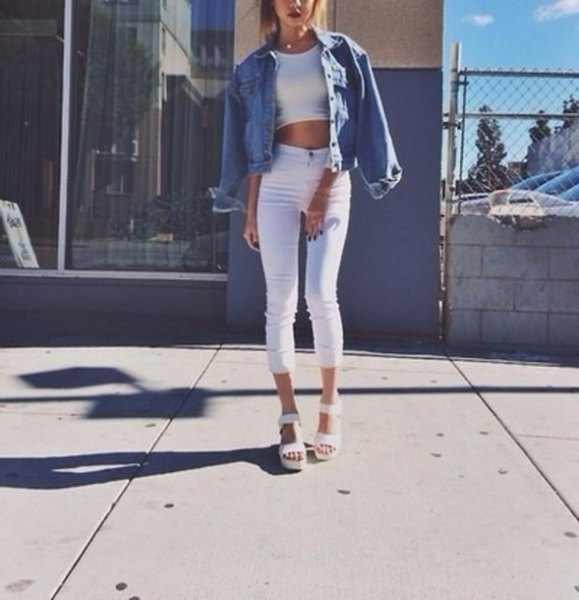 white crop top with blue denim jacket and high rise cropped jeans