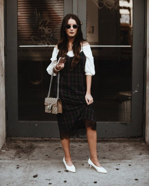 white puff sleeve off the shoulder blouse with black and burgundy plaid shift dress