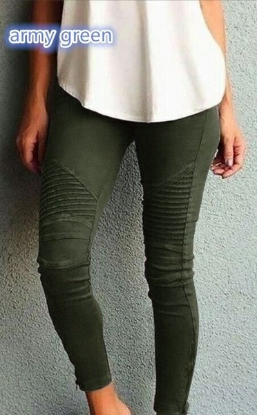 white relaxed fit tank top with dark green pleated skinny jeans