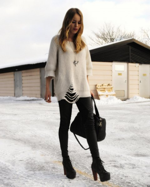 white ripped chunky sweater with black skinny jeans