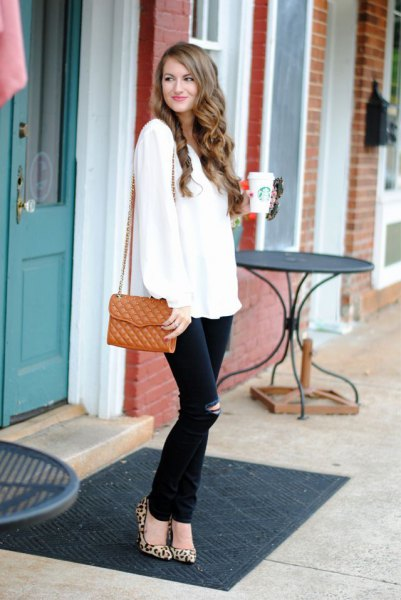 white sweater with black ripped jeans and leopard heels