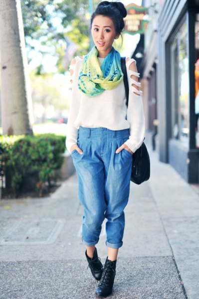 white sweater with silk scarf and cropped light blue pleated jeans