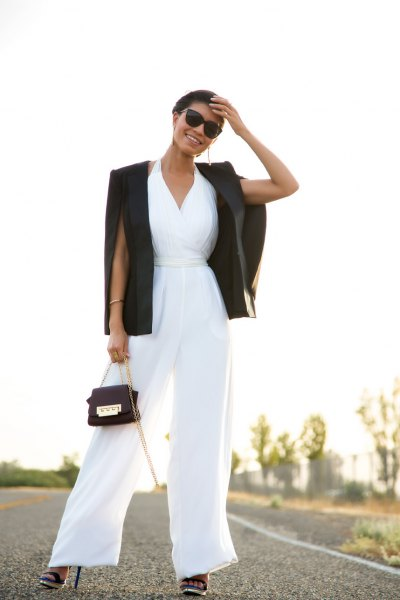 white v neck fit and flare jumpsuit with black blazer