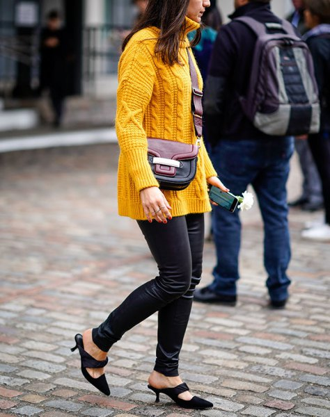 yellow cable knit sweater with black skinny leather pants