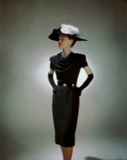 Model Wearing Black Dinner Dress and Hat