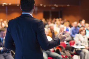 iStock conferences 1 - Speaker at Business Conference and Presentation.