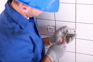 photodune 4933393 electrician installing switch on wall l 1 - Electrician installing switch on wall