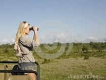 blond-woman-looking-binoculars-jeep-side-view-young-safari-standing-33900615