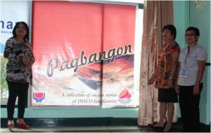 (From L-R) SLP RPC Elizabeth Saavedra, Kalahi-CIDSS RPC Marilyn Fabian and ARDO Consejo H. Usman pose shortly after unveiling the life-size Pagbangon Book Cover.