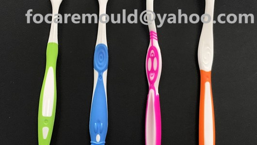 bi component molds toothbrushes