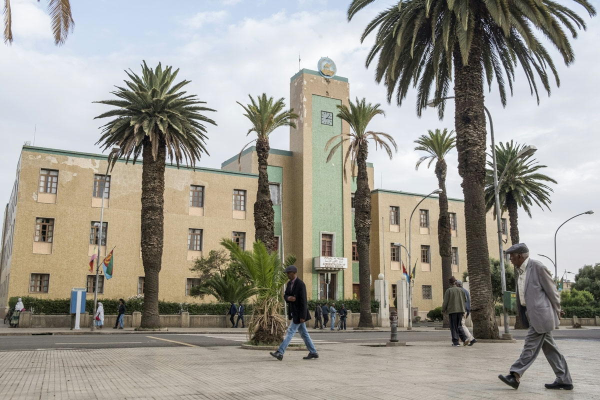 A man walks past a government building in the Eritrean capital Asmara on July 21, 2018.