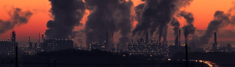 Smoke emitting from power plants over a dark city