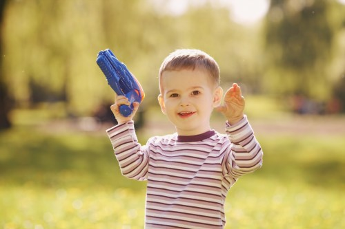 portrait of little boy with water gun