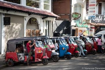 A row of three-wheelers waiting for tourists in Kandy, Sri Lanka